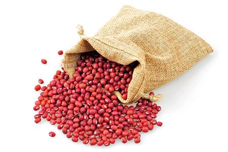 Red adzuki bean and sacks on a white background