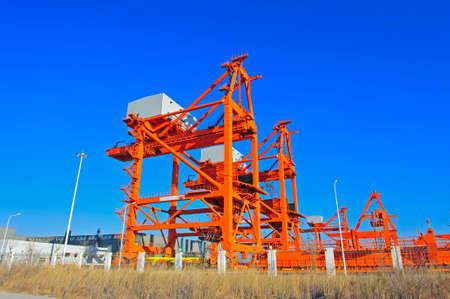 bulk carrier: Port crane bridge and bulk carrier Editorial