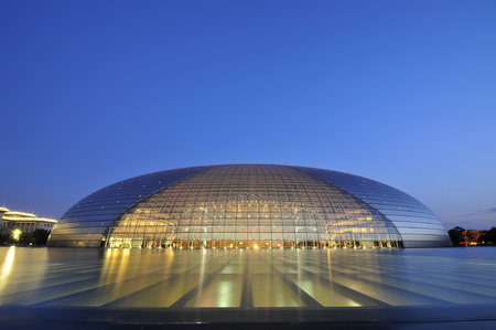 Beijing, China - on August 11, 2014: the beauty of the national grand theater, the national grand theatre in the evening, Beijing's most famous landmarks 스톡 콘텐츠