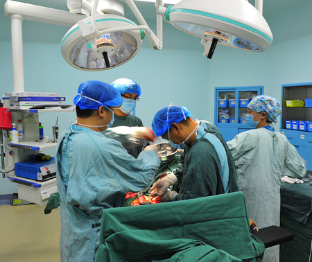 operating room: Surgical team operation in the operating room