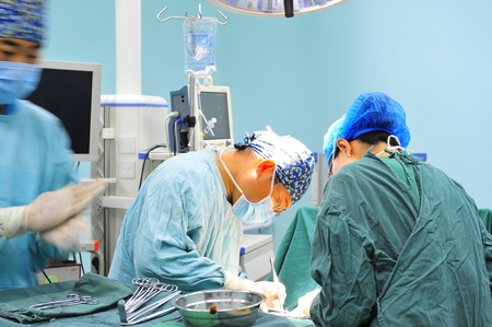surgeons hat: Surgical team operation in the operating room