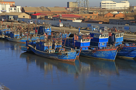 ethnic mix: Fishing boat moored at the pier