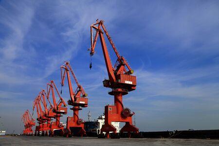 bulk carrier: Port crane bridge and bulk carrier Stock Photo