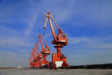 shipbuilding: Port crane bridge and bulk carrier Editorial