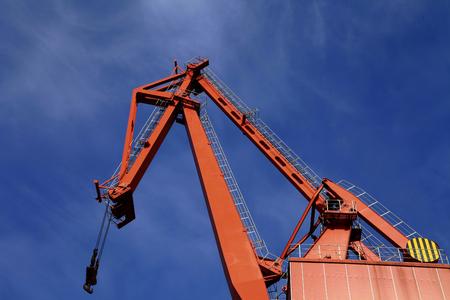 shipbuilding: Port crane bridge and bulk carrier Stock Photo
