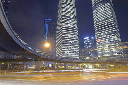 Light trails on the background of the modern architecture in Shanghai, China