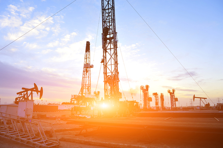 oil and gas industry: Oil Pump at sunset Editorial
