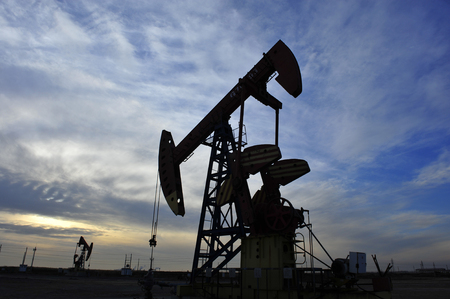 oil and gas industry: Oil Pump on orange sunset