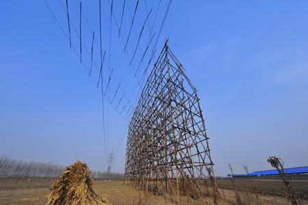 Pylon construction workers Stock Photo