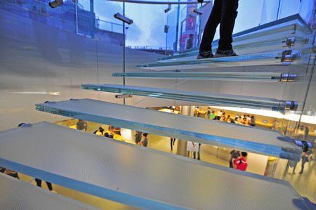 Modern glass stair outline walking man in Shanghai, China  免版税图像