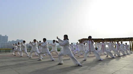 Tangshan - May 26, 2018: tai chi performance, to the south of the luanhe river, tangshan city, hebei province, China. Editorial