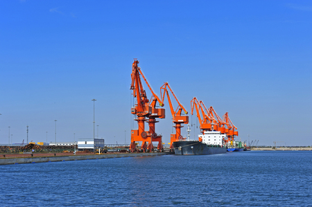 Port crane bridge and bulk carrier Stok Fotoğraf
