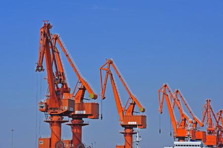 Port crane bridge and bulk carrier Stock Photo