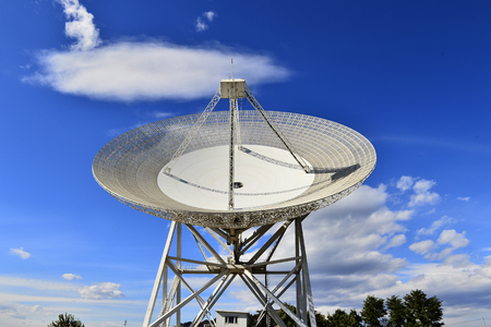 Array of satellite dishes or radio antennas against sky. Space observatory.
