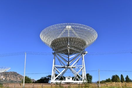 Array of satellite dishes or radio antennas against sky. Space observatory. 免版税图像 - 110836374