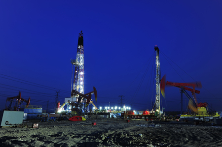 Oil drilling rig in the evening