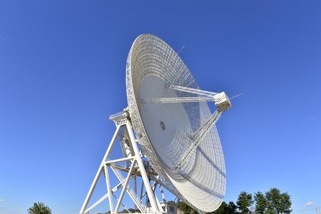 satellite dishes or radio antennas against sky.