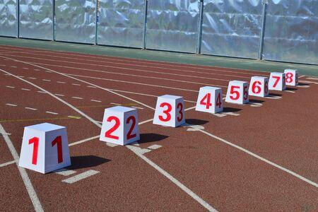 Lane number blocks on running track