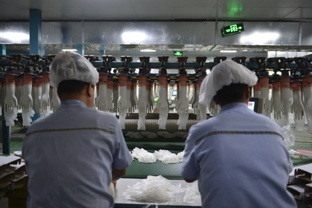 Rubber gloves production line in the rotation Editorial