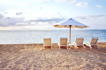 Four Chair and Umbrella at the Beach Stock Photo