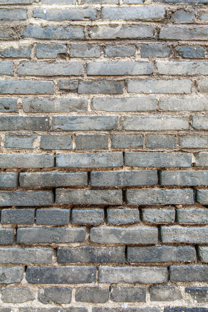 Gray brick wall texture background material Imagens