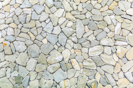 Stone wall texture background material Фото со стока - 108306172