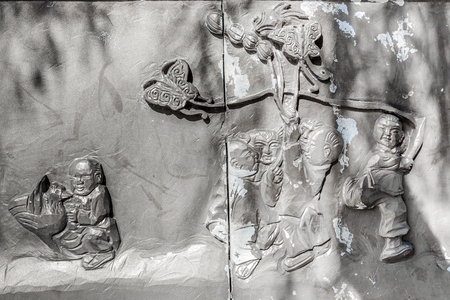 Urban historical folk relief wall carving Reklamní fotografie