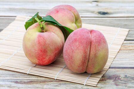 Few sweet peach on the table 写真素材