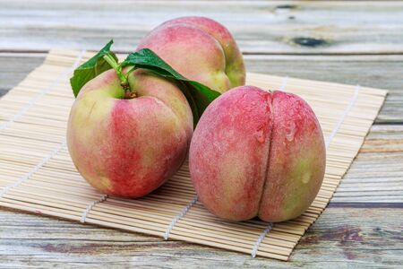 Few sweet peach on the table 스톡 콘텐츠