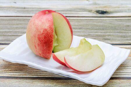 a cut peach on the table