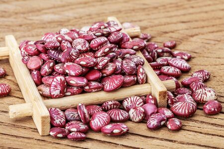 Zebra beans on wooden texture desktop