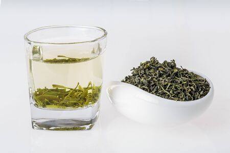 Green tea and tea leaves Stock Photo