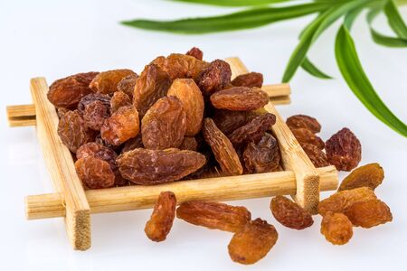 Dried raisin on white background