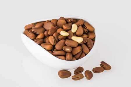 Pine nuts on white background Stock Photo