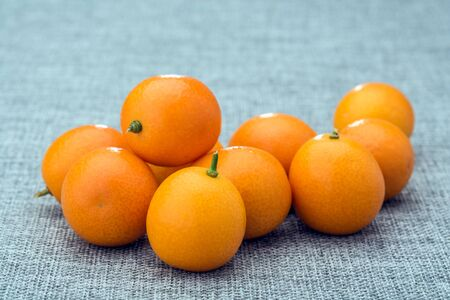 A bunch of kumquats Stock Photo