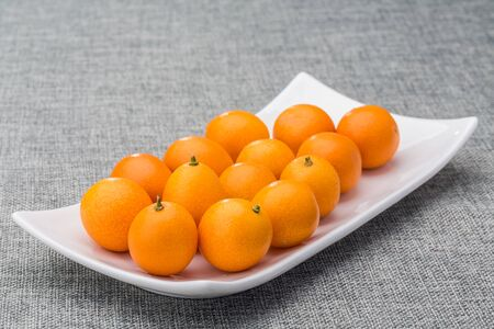 Kumquats on white plate