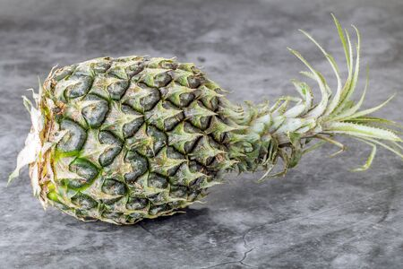 Pineapple on table Stock Photo