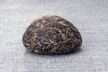 Pu'er tea leaves on grey tablecloth 写真素材