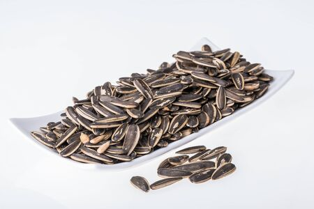 Sunflower seeds on white background Stock Photo