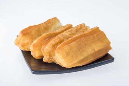 Youtiao (long golden-brown deep-fried strip of dough) on plate