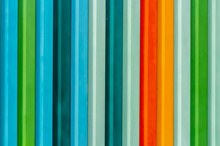 A beautiful horizontal texture of colorful red green blue orange yellow gray metal fence 版權商用圖片