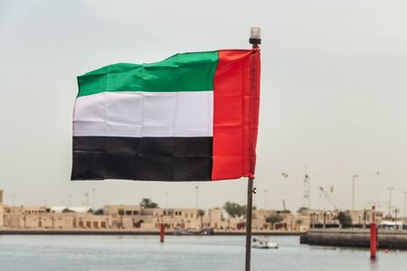 One rectangular colored flag is on the sea bank background