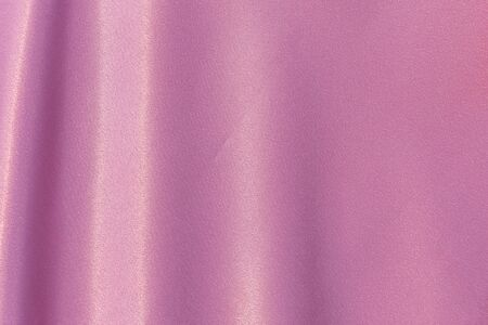 A beautiful horizontal texture of pink silk curtain fabric or textile for hand made sewing 写真素材