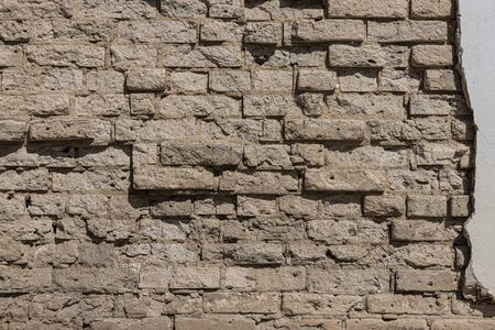 A beautiful horizontal texture of part of an old orange crushed brick wall