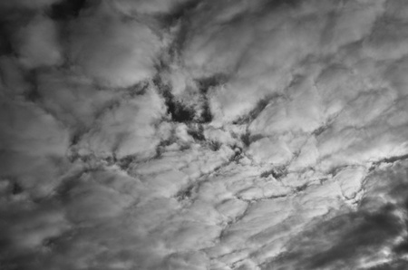 presentiment: White clouds on a gray sky