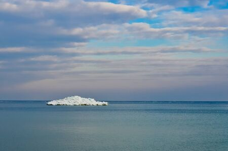 Small iceberg on the horizon