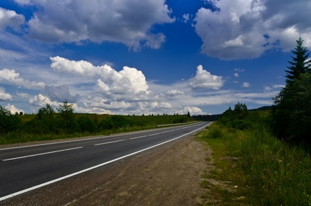 The way - a empty highway on a sunny day and blue beautiful sky photo