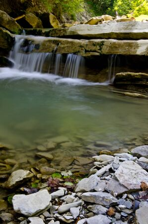 Small waterfall on mountains river Stock Photo