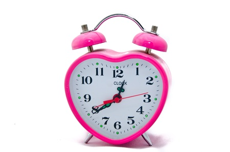 Pink Valentine alarm clock - in the form of heart isolate Stock Photo - 17280850