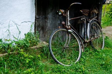 Old bicycle near the house in the village
